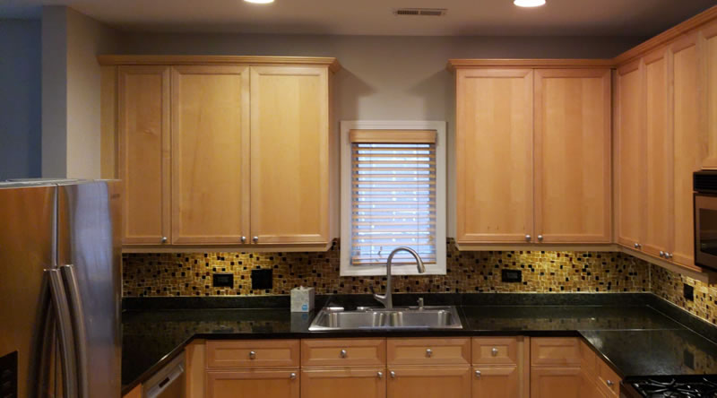 A Simple Guide To Refinishing Your Kitchen Cabinets